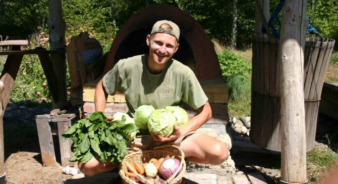Daniel from Hawthorn Farm shows cabbage and other vegetables raised by hand.