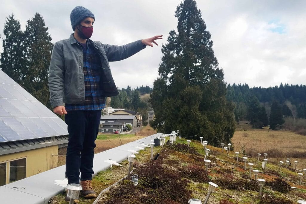 On a virtual building tour of the 21 Acres living roof, Barry Febos explains how local carbon credits can help with climate change and polluted urban areas.