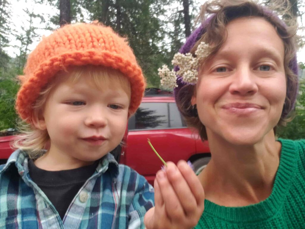 Dr. Sarah Sue Myers and her son Leo explore herbal remedies in the garden.