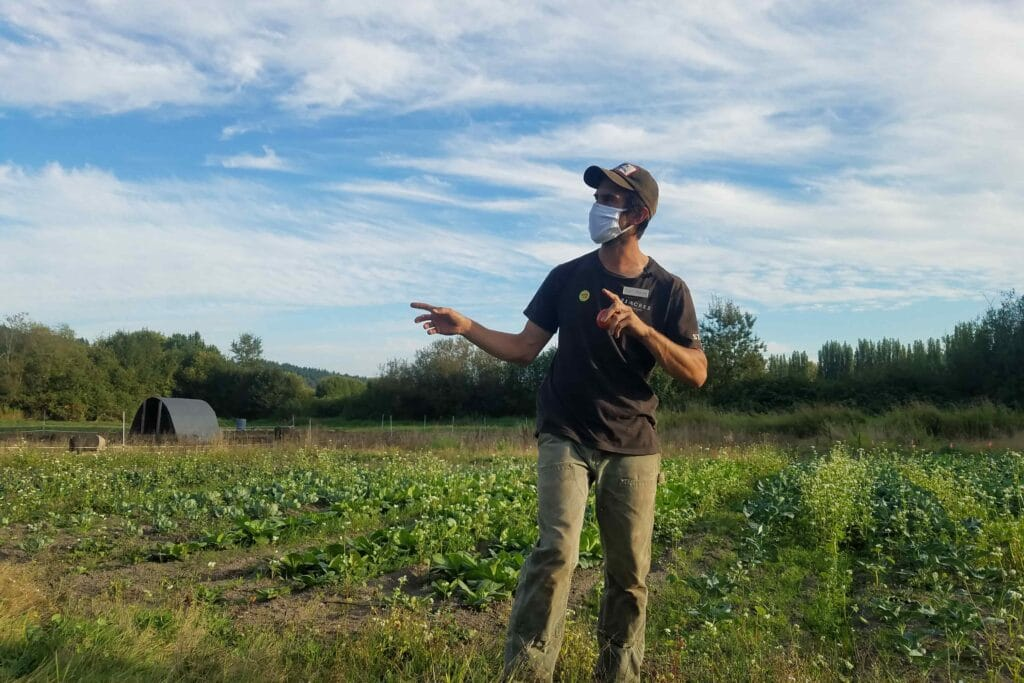 Farm Operations Lead Anthony Reyes explains the WSU cover crop trial on the 21 Acres campus.